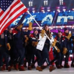 American athletes walk into the Opening Ceremony led by flag bearer Erin Hamlin who competed in Luge.